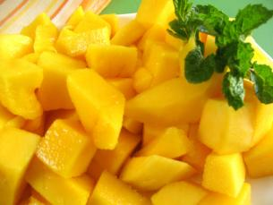 How to cut a mango start cooking they are in season from may to september when you buy a mango it should have a fragrant fruity aroma and yield slightly to pressure from your thumb ccuart Choice Image